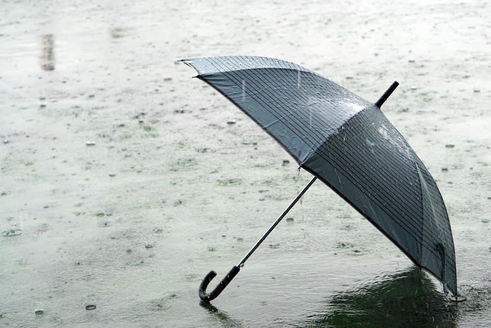 Umbrella on the street on a rainy day.