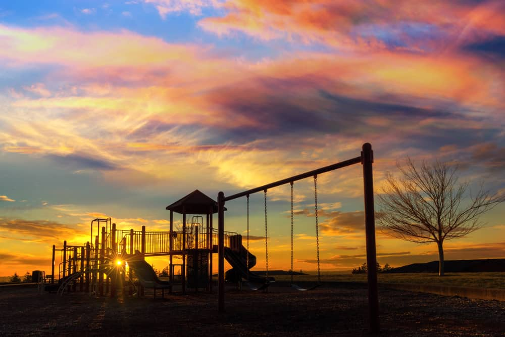 Children's playground in Happy Valley, Or with sunset